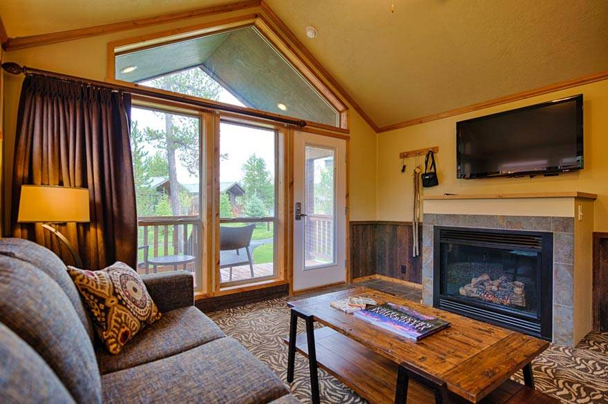 Unwind in front of a fireplace and flat screen TV in our Old Faithful cabins.