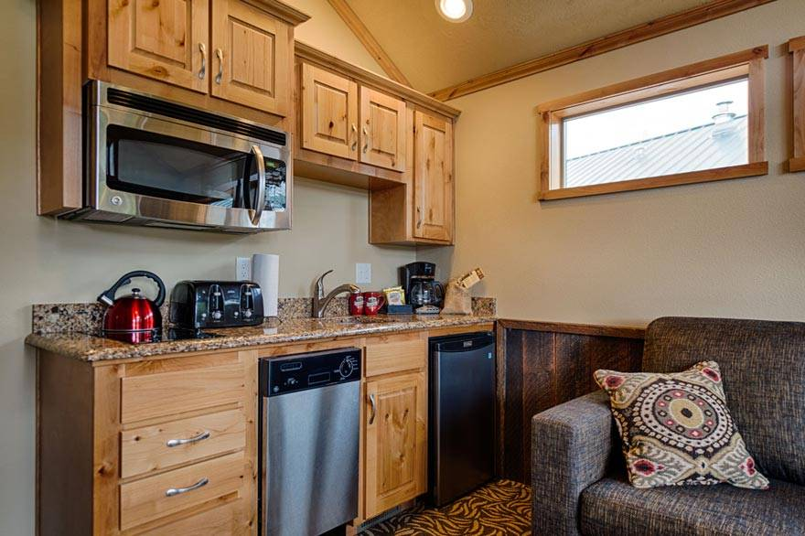 Kitchenettes in our Old Faithful cabins include a microwave, dishwasher, toaster, stove top, and much more!