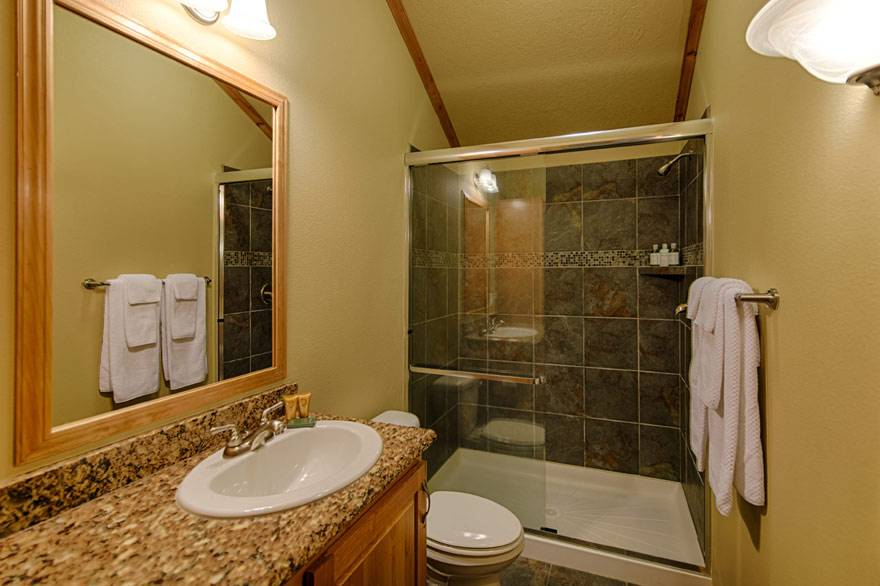 Enjoy a private bathroom with granite counters in every Explorer Cabin.