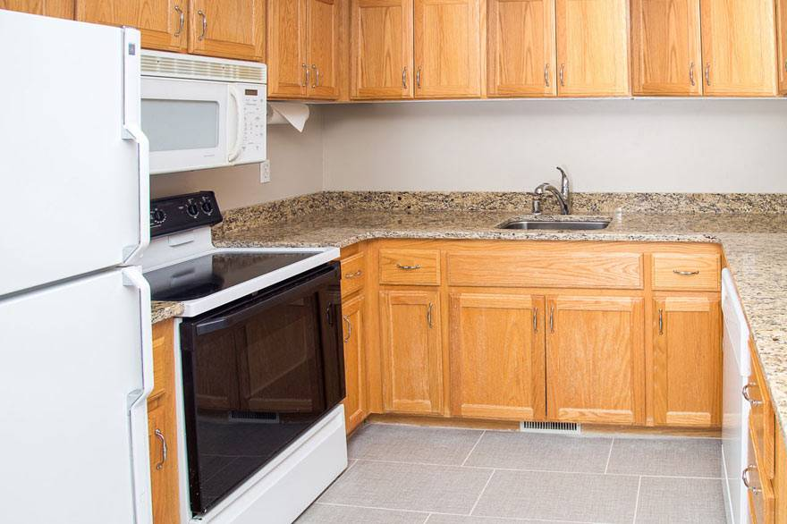 The Gray Wolf Inn and Suites family suite features a full size kitchen with plenty of room.