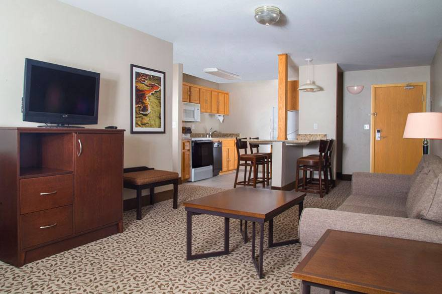 Gray Wolf Inn family suite with living room and kitchen