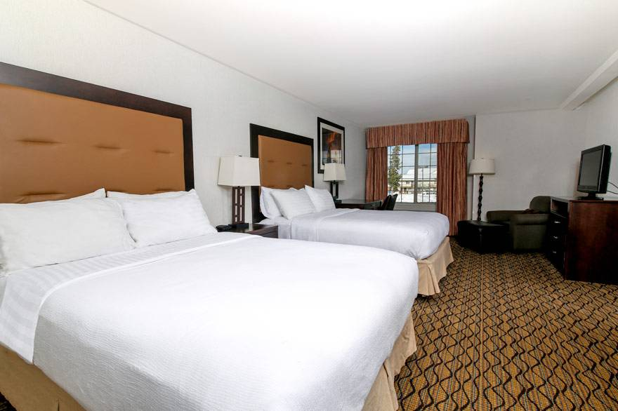 Our Holiday Inn family rooms feature 2 separate rooms; one with 2 queens, and one with 1 king.