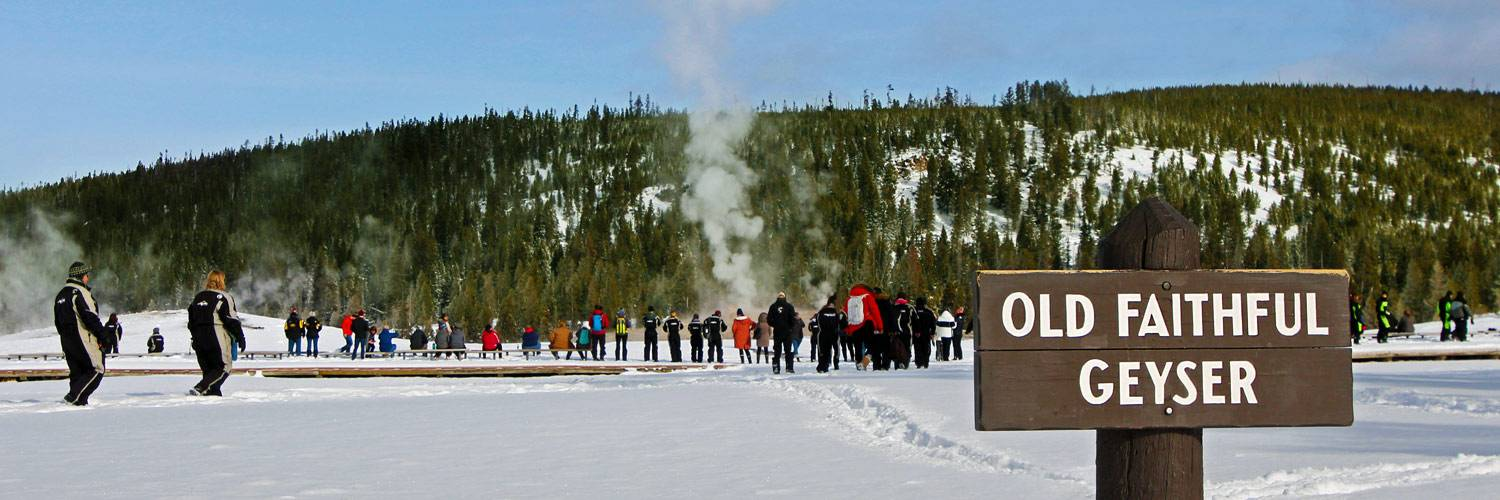 Yellowstone visitors exploring Old Faithful in winter