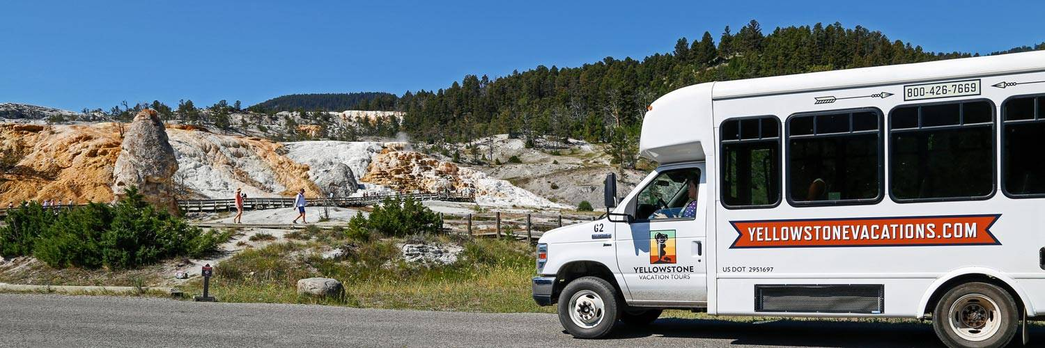 Yellowstone Vacation Tours bus at Mammoth Hot Springs