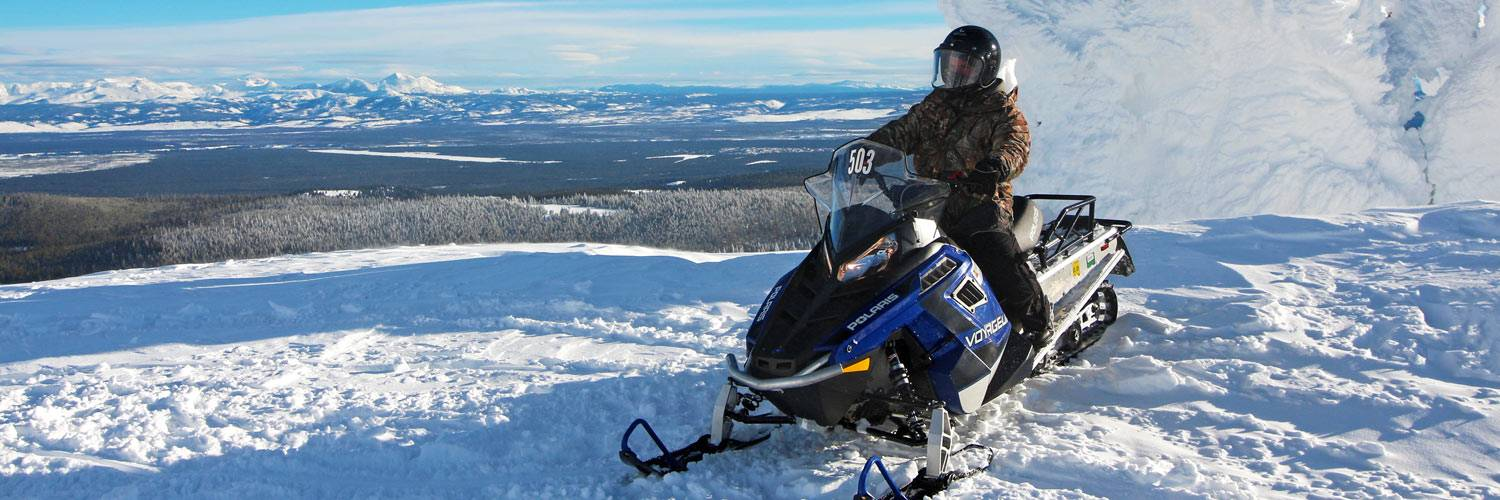 Snowmobiler in Yellowstone National Park during the winter