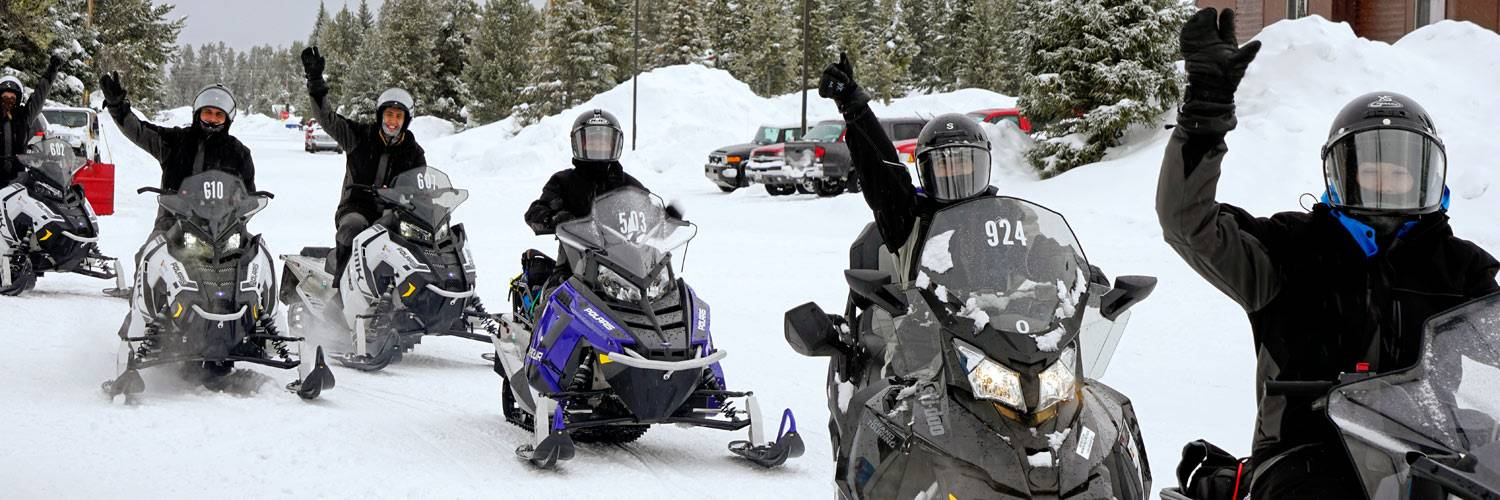 A group of snowmobile riders in West Yellowstone, MT