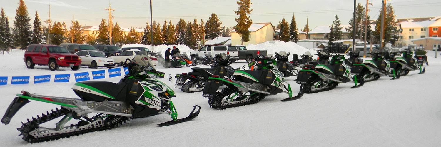 Snowmobiles lined up outside Yellowstone Vacations
