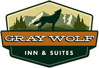 Gray Wolf Inn and Suites logo