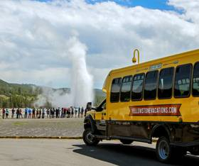 A fall bus tour to Old Faithful geyser