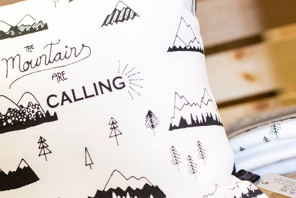 The Mountains are Calling pillow available for purchase at Yellowstone General Stores