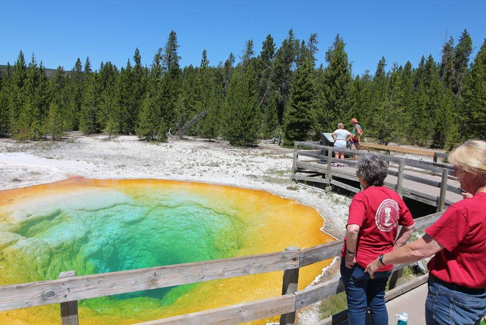 Yellowstone Vacations employees at Morning Glory Pool