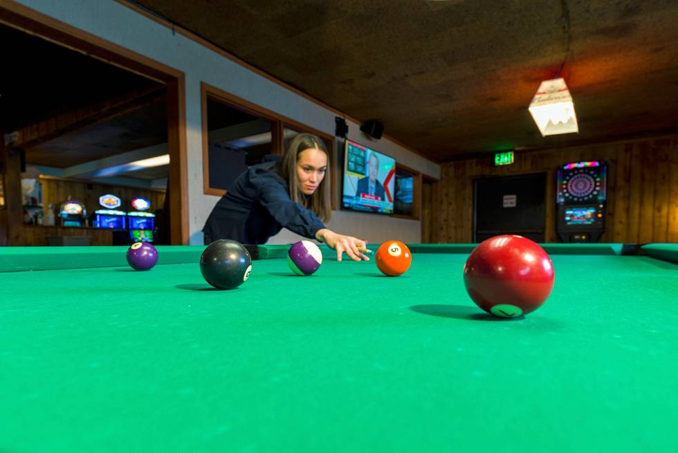 A guest shooting pool at The Yellowstone Mine Restaurant and Bar