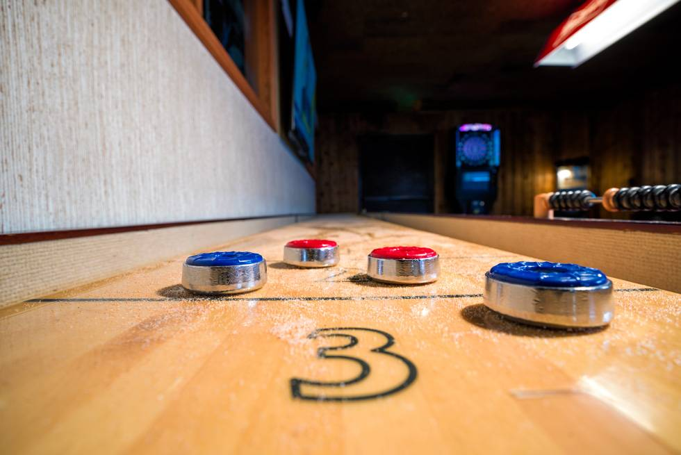 Enjoy a game of shuffleboard at The Yellowstone Mine Restaurant in Gardiner, MT