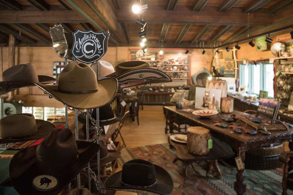 A display of cowboy hats inside Yellowstone General Store