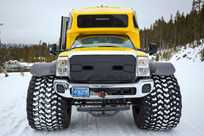 Our fleet of snowcoaches features oversize tires to easily drive over the snow.