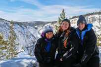 Girls posing at the Grand Canyon of the Yellowstone in winter
