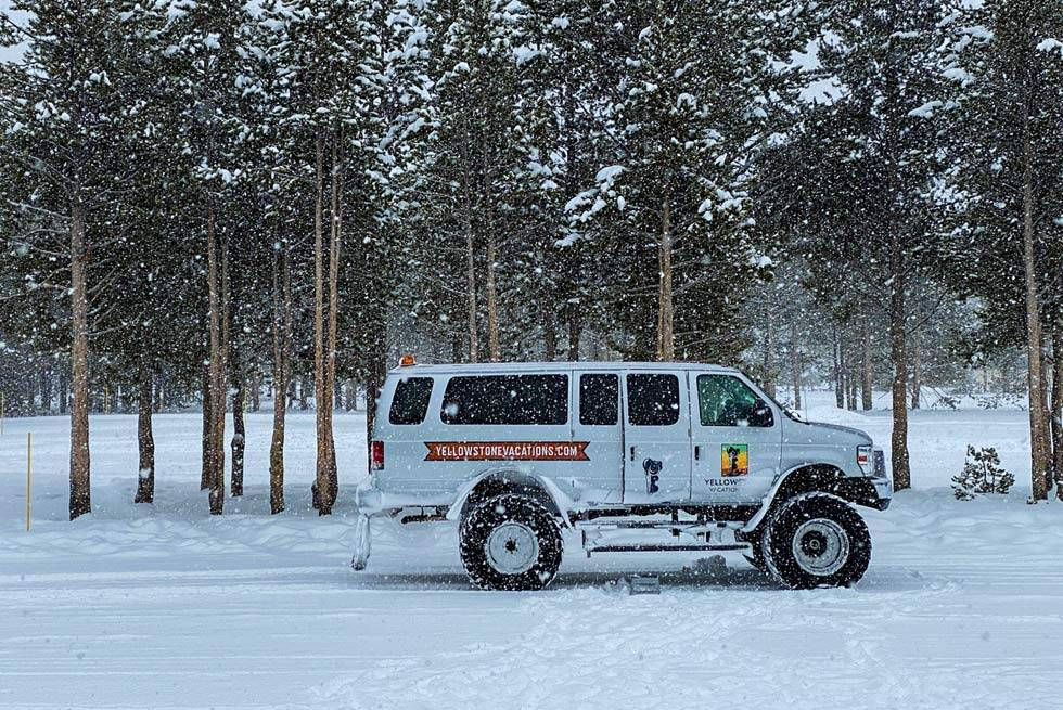 A Yellowstone Vacation Tours snowcoach from Gardiner, MT