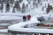Yellowstone's geyser basins may be crowded during the summer, but in winter you'll have them all to yourself!