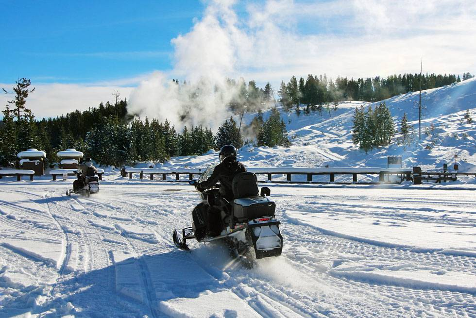 Yellowstone snowmobile rider at Mud Volcano