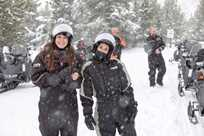 You literally can't stop smiling when you're on a Yellowstone snowmobile tour.