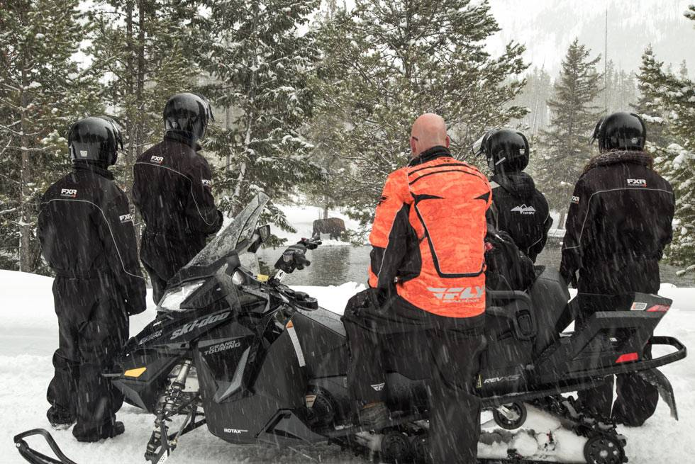 This Yellowstone snowmobiling group takes a stop to witness a rare sight...