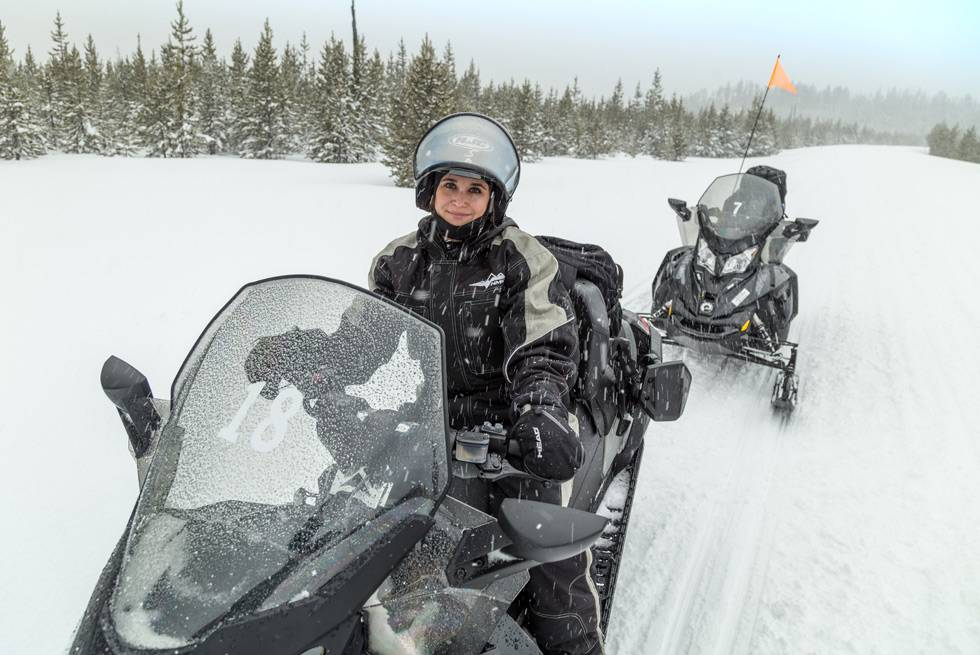 Riding a snowmobile is almost as simple as steering a lawnmower. Anyone can do it!
