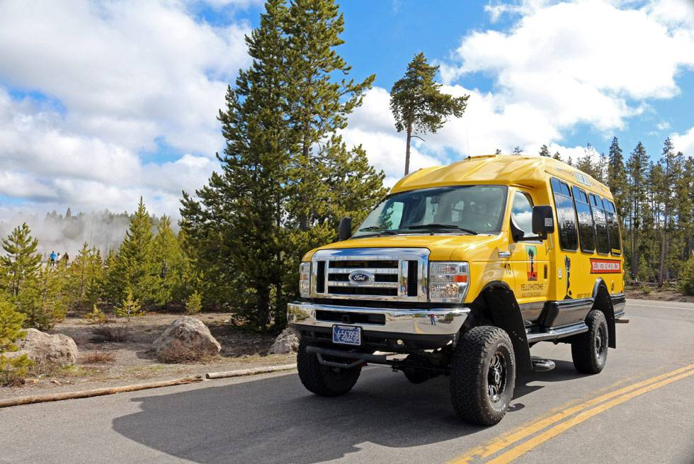Experience comfortable coaches and knowledgeable interpretive guides with Yellowstone Vacation Tours