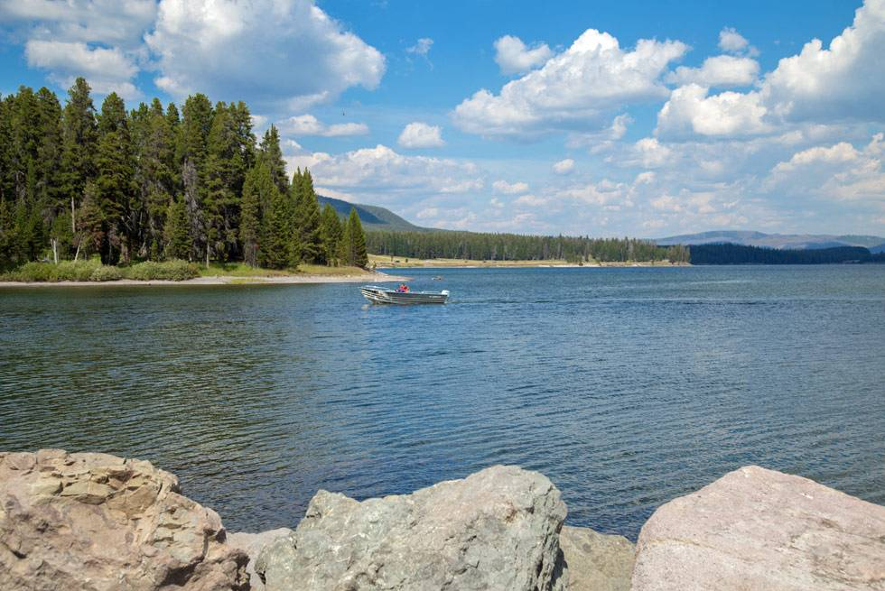 A boater on Yellowstone Lake, seen from one of our Summer Bus Tours
