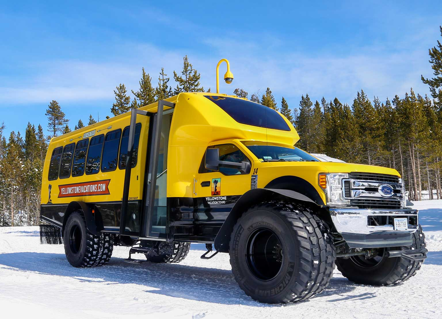 A Yellowstone Vacations snowcoach in winter