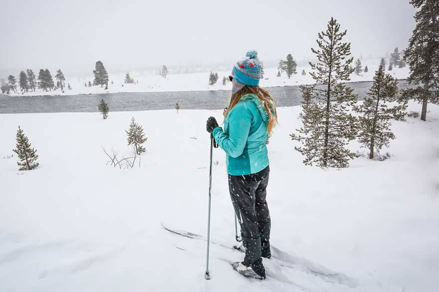 Young lady cross-country skiing at Yellowstone National Park