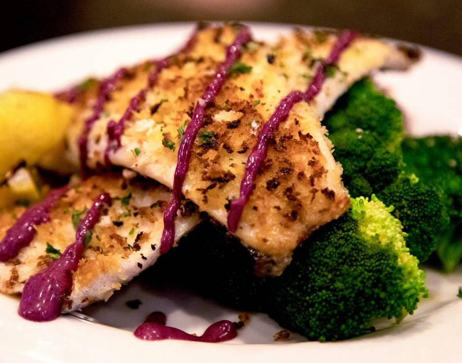 Chicken entree with broccoli and huckleberry sauce at Branch Restaurant and Bar